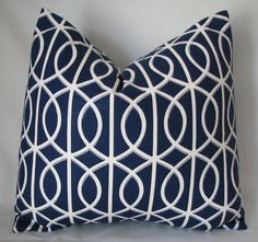 Navy blue pillow with white pattern