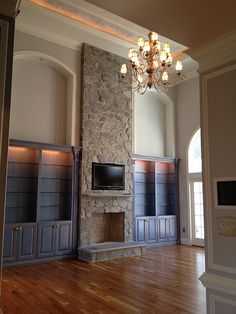 i am having a heck of a time trying to figure out furniture placement in a great room. I don't know what to do if there is a fireplace in the room and a tv. do you put it over the fireplace? is that too high? i didn't grow up with a great room nor do i have one now. I'm used to more rectangular room...