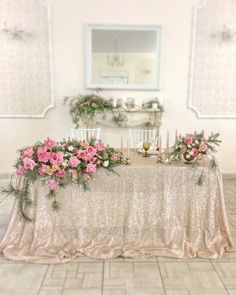 Inspiration for repurposing the ceremony arch decor for the sweetheart table.