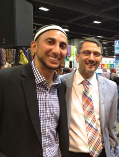 Zaytuna College co-founder Dr. Hatem Bazian and Rami Nashashibi of the Inner-City Muslim Action Network (IMAN) at the ZC booth at the 2013 ISNA convention in Washington, D.C.