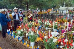 Mariachi group playing at a flower covered grave, Dia de Muertos (Day of the Dead) celebrations in a cemetery in Tzintzuntzan, Lago de Patzcuaro, Michoacan state, Mexico, North America Stock Photos