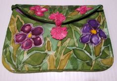 Multi-colored silk purse, carefully handpainted using the finest French silk dyes and resists. Drawstring top closing and silk lining. The floral design covers front and back and has rich tones of blue, yellow, violet and gold. This is a one of kind piece, signed by the artist, and cannot be duplicated. No two purses are ever the same. #silkworth