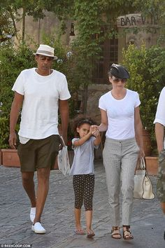 Hold on tight: Ellen and her music producer husband, who married in 2007, welcomed their s...