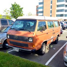 A VW Vanagon spotted at UBC, Vancouver. Burnt Orange with a rare wave decal.