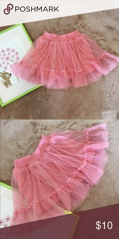 Xhilaration pink skirt Flowy skirt in size XS (4-5) with pink lining and mesh see through outer lining with ruffle details and comfortable elastic band. 100% polyester. In excellent condition, no known holes, stains or defects. Shows normal wear & wash. From smoke & pet free home.All clothes are completely washed/dry cleaned & ready to wear before being shipped! Xhilaration Bottoms Skirts