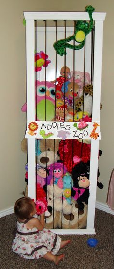 DIY stuffed animal zoo by keeper of the cheerios  Made this for my daughters' stuffed animal collection... used pink bungee cord I bought off amazon