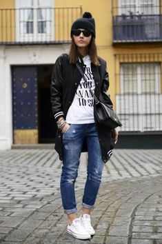 Uber-cool fall outfit: Varsity jacket, denim, and white sneakers.