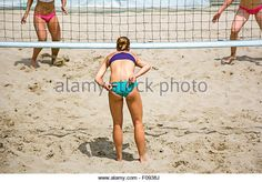 Young girls playing Beach Volleyball in sunny day - Stock Image