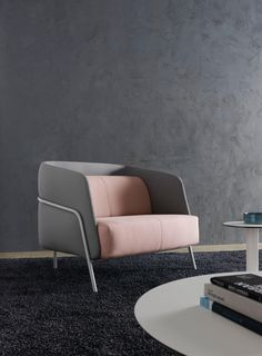 Armchair and two seat sofa with a low and a high seat back. The Noldor collection is a system of modern upholstered seating specifically designed to..
