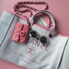 Chanel white pearls runway round sunglasses | chanel pink patent leather compact wallet | chanel large pink Deauville bag 31 rue cambon paris