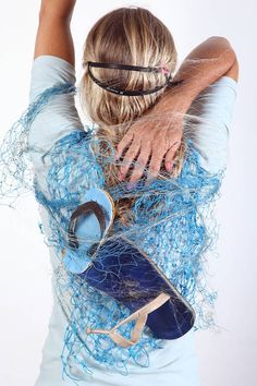 Artist depicts humans trapped in ocean waste