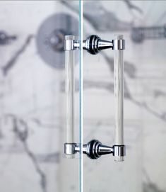 Morgan Harrison Home: Marble shower with seamless glass door and lucite shower door handle.