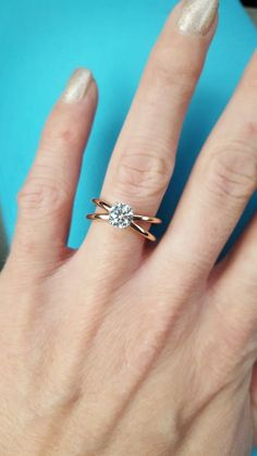 14K Rose Gold Criss Cross Diamond Solitaire Engagement Ring with Round Cut Diamond | James Allen Ring Style: 17975R14 | Click to see this ring in 360° HD!