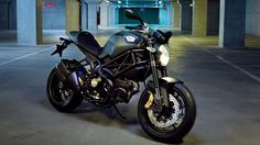 "Ducati Monster Diesel - ""The Beast"" military-style, With olive green paint and matte black highlights."