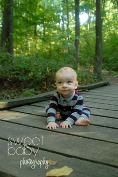 baby boy photo idea ~ green grass ~ on a bridge ~ 8 month old photo shoot ~ baby boy ~ collared shirt ~ sitting up ~ in the woods ~ photo idea