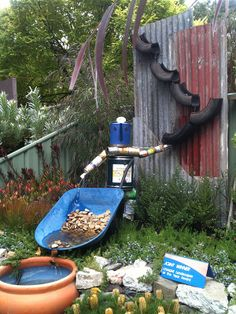 Garden Crafts From Recycled Materials | WATER+FEATURE+MADE+FROM+RECYCLED+MATERIALS+OLD+CANS+TYRES+MIFGS+2012 ...