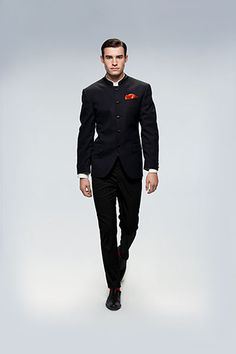 Indo-Western Sophistication This Navy Blue Bandhgala is the perfect definition of suave fusionwear. Add a touch of vibrance with Red accessories.