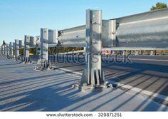 Anodized safety steel barrier on freeway bridge - stock photo