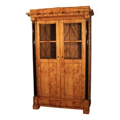 View This Item And Discover Similar Wardrobes And Armoires For Sale At    German Biedermeier Flame Birch Armoire With Ebonized Columns.