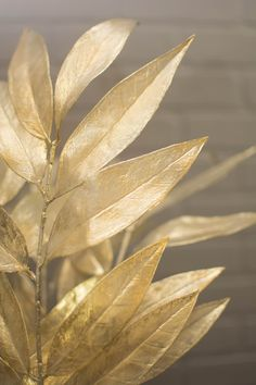 Our golden leaves add nobility to your centerpieces, event displays and wedding tables. This set of six 20 inch long sprays contain 5.5 inch long x 1.5 inch wide golden bay leaves. The stems and reflective leaves can be bent into the shape you desire allowing you to use them in a variety of ways: as part of a floral centerpiece, wrapped around a cake stand, or even as part of a rich toned wedding bouquet.
