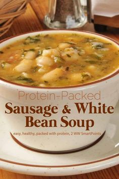 With Italian-style chicken sausage tons of veggies beans and escarole this protein-packed soup is sure to make your belly warm full and happy. Substitute escarole with any leafy green of your choice if you prefer. Healthy Food Recipes, Easy Soup Recipes, Healthy Soup, Diet Recipes, Cooking Recipes, Dinner Healthy, Recipies, Italian Sausage Recipes, Beans Recipes