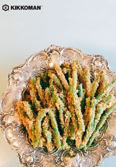 Bring some crunch to a side dish of green beans by adding Kikkoman Panko Bread Crumbs to the equation, plus Italian Parmesan cheese for a little extra flavor. You can easily serve these as a crispy snack or appetizer, they make a delicious side to any meal, or present them on a festive platter to complement a holiday feast. | Discover hundreds of side dishes and meal recipes at KikkomanUSA.com.