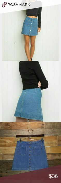 🌟SALE🌟BRANDY MELVILLE DENIM SKIRT BRANDY MELVILLE SOLD OUT LIKE NEW COLOR MEDIUM DENIM SIZE SMALL BUTTON UP FRONT 2 FRONT POCKETS HIGHLY DESIRABLE TRENDY AND FUN MINI DENIM SKIRT 100% COTTON *NO TRADES NO RETURNS* POSH MARK TAKES 20%-PRICE FIRM UNLESS BUNDLED Brandy Melville Skirts Mini