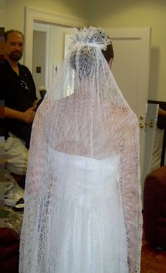 hand knit wedding veil, beautiful.  I might do this, I really want to at least, but sometimes they end up looking too thick and heavy (not this one of course).