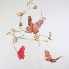 Butterfly Mobile - handmade fabric mobile in cherry blossom pink, strawberry red, peach, cream, taupe, coffee, lavender, and white. $98.00, via Etsy.