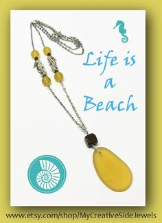 Yellow sea glass pendant necklace with seahorse charm accents.  SHOP: https://www.etsy.com/shop/MyCreativeSideJewels