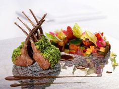 pistachio crusted rack of lamb with sautéed spring vegetables and lavender sauce.