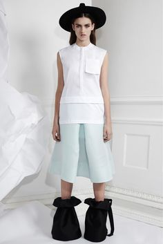 She incorporated fluidity through lace and floral print into her architectural aesthetic in this collection. Her structural silhouettes are somewhat softened through the use of pastels and soft folds of fabric. The skirt looks like a pant with a panel in between - explore this [Ellery | Fall 2013 RTW | style.com]