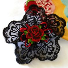 Red Rose Rockabilly Hair Accessories by missrockabilly, $28.00 (not digging the price, but DIY for the bridesmaids)