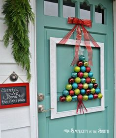 Who says Christmas balls are only for the Christmas tree? You can get out of your way and arrange the extra Christmas balls to form a tree shape and decorate your front door with it.
