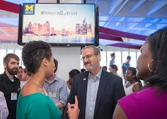 "UMich President Mark Schlissel speaks with attendees of the ""U-M + Detroit"" reception that took place on July 28th #InternDetroit"