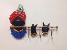 - Bring good luck with this auspious key holder having Krishna.It is made from wrought Iron which reflects the artistic brilliance and it adds elegance to your decor. Style your home and office with t