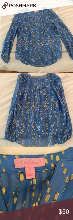 Lily Pulitzer blue gold loose top size small Beautiful bright blue with gold detailing blouse by lily. Size small fits loosely a small or medium could wear this. Perfect condition worn maybe 1-2 times Lilly Pulitzer Tops Blouses
