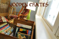 Some simple wooden crates would be great for books, stuffed animals, you name it.   Instructions at http://www.apartmenttherapy.com/nursery-tour-ezras-charming-sp-102074