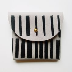 COIN PURSE // ivory leather with black strokes. via Etsy.