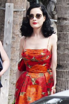Dita in Miami wearing Louis Vuitton sunglasses and a Vintage 50s day dress.