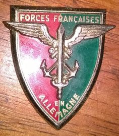 Very Rare Obsolete French Forces in Germany Badge. NO PINS