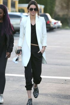 If ANYONE can make a white blazer and sweatpants look chic, it's Kendall Jenner