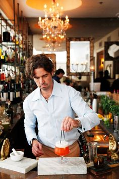 Southern Living | Why We Love New Orleans | Alan Walter mixing drinks and prepping the Loa Bar