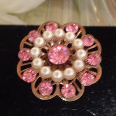 15% off 40617 Pink Rhinestone and Small Faux Pearls with a Center Pink Rhinestone and Measures 1 inch in Diameter.