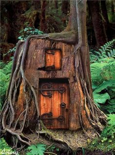 fairy tale treehouse, tree trunk house, nymph house, wrought iron embellished door hinges, forest