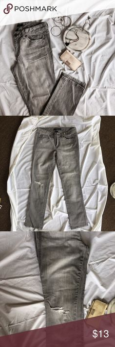 """Grey Calvin Klein Denim Grey Calvin Klein Denim: straight fit. Actual fit name is """"pencil"""". Fitted through thigh and then straight through calf. Only worn a handful of times. Great condition! Features some destroy on thigh and then a hole in the knee. Calvin Klein Jeans Jeans Straight Leg"""