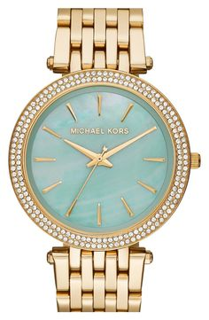 In love with this sparkly gold watch with a mint dial for a chic look.