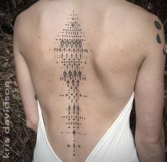 Back tattoo inspired by the nervous system. Tattoo artist: Kris Davidson