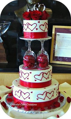 What a fun and Elegant Valentine Wedding Cake - Round Buttercream Wedding Cake with Red Hearts, Red Roses and Wine Glass Pillars from Graceful cake creations Gorgeous Cakes, Pretty Cakes, Amazing Cakes, Dessert Oreo, Wedding Cake Red, Valentines Day Cakes, Buttercream Wedding Cake, Occasion Cakes, Fancy Cakes
