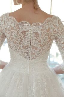 Magnificent+Lace+Ball+Gown+exudes+luxury.+Grace+Kelly+would+have+swooned+over+this+amazing+wedding+dress.++Dress+has+a+sheer+lace+bodice+and+back.+Scalloped+lace+edging+adorns+the+neckline.+Lace+applique+is+lightly+beaded+and+cascades+from+the+waistline+to+the+top+of+the+skirt.++Gown+features+long+lace+sleeves.+Extra+fabric+may+be+ordered+to+cover+the+bodice+and+back.+